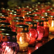 Many glass lamps with lights from candles. — Stock Video #12818697