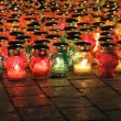 Many glass lamps with lights from candles. — Stock Video #12818706