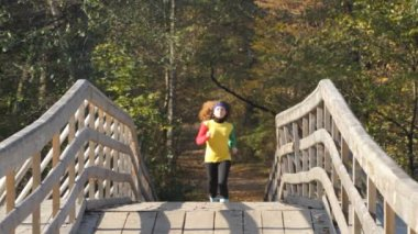Running girl on a bridge