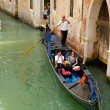 Stock Photo: Gondolier on a gondola