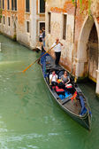 Gondolier on a gondola — Stock Photo