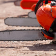 Stock Photo: Orange chainsaw stands
