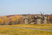 Old wooden windmill in autumn — Photo