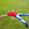 Man relaxation on a green grass — Stock Photo