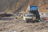 Garbage machines unload garbage  — Stock Photo