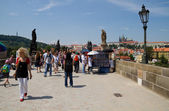 People visit the Charles Bridge in Prague.  — Stock Photo