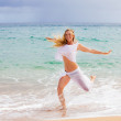 Pretty Fit Woman running in the water — Stock Photo #12228473