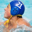 Teenager in Pool with Head Gear on - Stock Photo