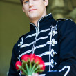 Handsome Man with roses - Stock Photo