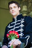 Handsome Man with roses — Stock Photo