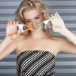 Woman holding Clamps — Stock Photo