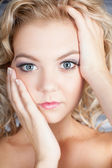 Pretty blond girl with a startled look — Stock Photo