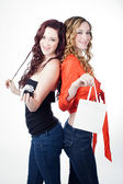 Beautiful Twin Sisters with Gifts — Stock Photo