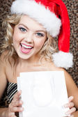 Ecstatic Beautiful Woman wearing a Santa Hat — Stok fotoğraf