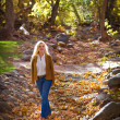 Pretty Woman in Autumn leaves — Stock Photo
