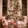 Christmas tree fully decorated — Stock Photo