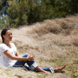 Stock Photo: Pretty Womsitting peacfully in nature