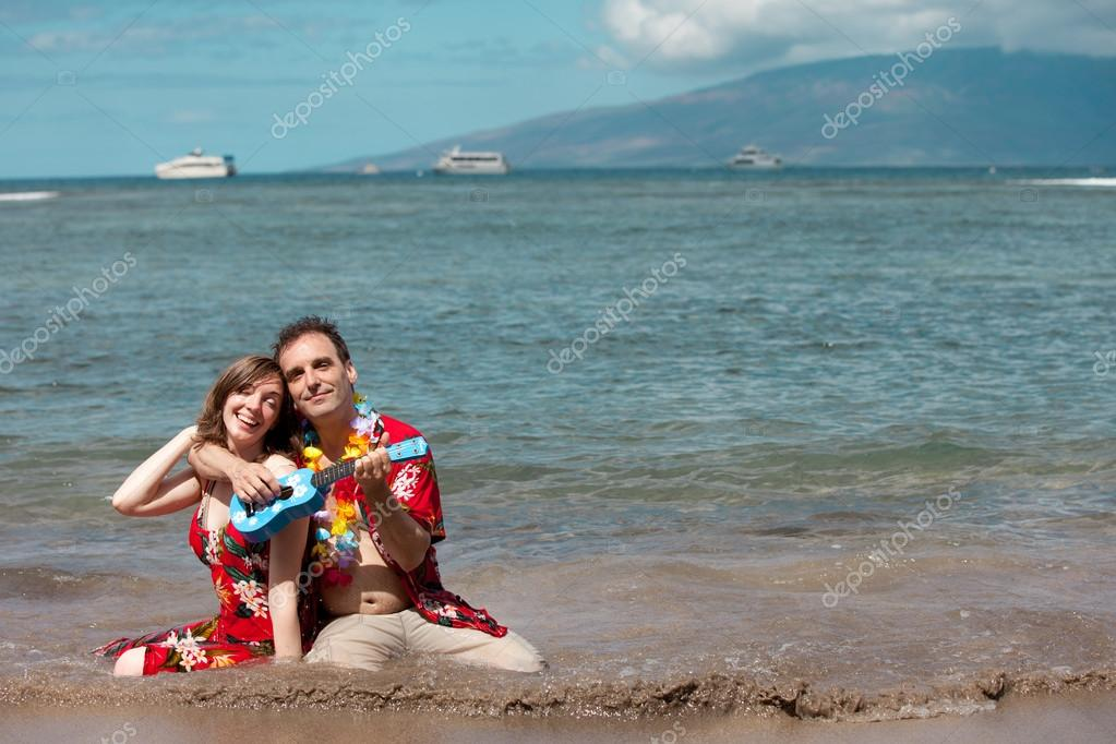 Man Serenading his new bride with a Ukelele in Hawaii  Stock Photo #17612113