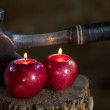 Candles in apples with Old hand Made Axe — Stock Photo