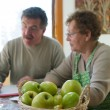 Mother and son with apples in the foreground — Stock Photo