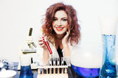 Smiling Sexy Scientist with red Valentine Love Potion — Stock Photo