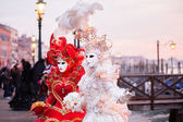 Beautiful costumed Venetian women — Stock Photo