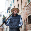Smiling Gondolier navigates on the channel of Venice — Stock Photo