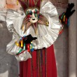 Venetian Carnival Maked Man as a harlequin - Stock Photo