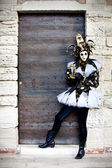 Beautiful Jester in Venice Italy by Ancient building doorway — Stock Photo