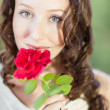 Pretty Woman with a rose — Stock Photo