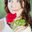 Pretty Woman with a rose — Stock Photo #18578497