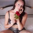 Pretty Woman with a rose — Stock Photo #18579445