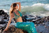 Beautiful Mermaid on Lava Rocks at the Ocean — Stock Photo