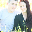 Young newleywed couple in bright sun — Stock Photo