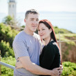 Romantic couple in front of a Lighthouse in California — Stock Photo