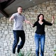 Young couple Jumping for Joy! - Stock Photo