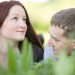 Couple in conversation at a meadow — Stock Photo