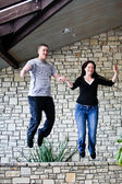 Young couple Jumping for Joy! — Stock Photo