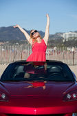 Beautiful Woman with Raised Arms in Convertible Car — Stock Photo