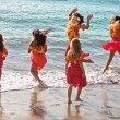 Polynesian Hula girls  in jumping in the ocean - Foto Stock