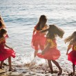 Polynesian Hula girls  in Friendship at the ocean - Stock Photo