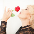 Beautiful Blonde woman and a rose — Stock Photo #19481557