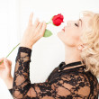 Beautiful Blonde woman and a rose - Stok fotoraf
