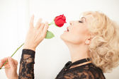 Beautiful Blonde woman and a rose — Stock Photo