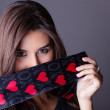 Beautiful Woman only wearing a love necktie and black — Stock Photo