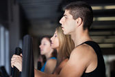 Young Muscular guy exercising — Stock Photo