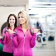 Pretty Women training at the Gym — Stock Photo