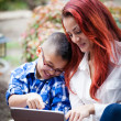 Mother and son reading from a touch pad — Stock Photo #21161945