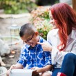 Mother and son reading from a touch pad — Stock Photo #21161741