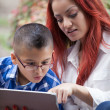 Mother and son learning from a touch pad — Stock Photo